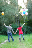 Happy future parents on the walk in summer park — Stock Photo