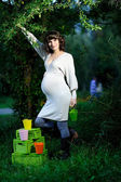 Happy young pregnant woman in the park — Stock Photo