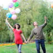 Happy future parents on the walk in summer park — Stock Photo #37196147