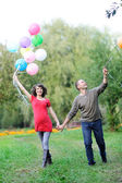 Happy future parents on the walk in summer park — Stock fotografie