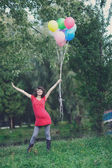 Happy young pregnant woman with balloons in the hands — Photo