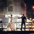 Bride and groom dancing in the night under rain — Stock Photo