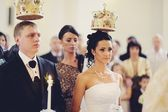 Bride and groom during church wedding ceremony — Stock Photo