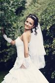 Young attractive bride posing outdoor — Stock Photo