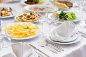 Table set service with silverware and glass stemware at restaurant before party  — Stok fotoğraf