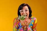 Pretty girl in glasses and snowdrops with funny emotions — Stock Photo