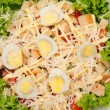 Fresh salad with chicken breast, cheese and eggs — Stock Photo #44449651