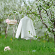 White coat, basket and bouquet in garden — Stock Photo #46131825