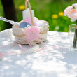 Bouquet of roses and  cup on the table in the garden — Stock Photo #46131829