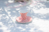 Pink cup on the table — Stok fotoğraf