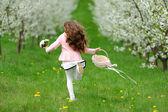 Little girl running in the garden — Zdjęcie stockowe