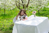 Little pretty girl in the green garden  — Stock Photo