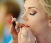 Makeup for bride on the wedding day  — Stock Photo
