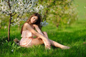 Girl in the blooming garden — Stock Photo