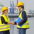 Greeting harbor workers — Stock Photo