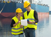 Dockers checking freight papers — Stock Photo