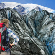Mountaineer facing his challenge - Stock Photo
