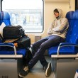 Young Man Sleeping In Train - Stock Photo