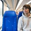 Young Man Travelling In Train - Stockfoto