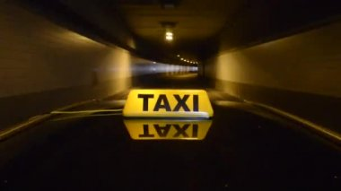 Taxicab driving through a tunnel