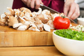 Midsection Of Man Cutting Mushrooms — Stock Photo