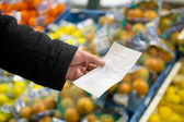 Shopping list with groceries — Stock Photo