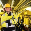 Foto Stock: Engine room worker