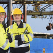 two dockers at an industrial harbor — Stock Photo