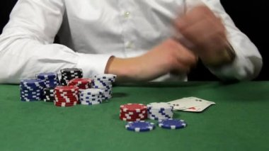 Poker player with a bad hand loses his bet
