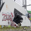 Stock Video: Running graffiti artist