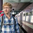 Young man traveling by train — Stock Photo #24049723