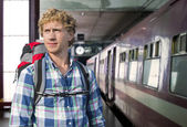 Young man traveling by train — Stock Photo