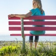 Pretty woman on pink bench — Stock Photo