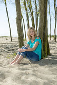 Woman sitting on beach — Stock Photo
