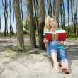 Young Woman Reading Book On Beach — Stock Photo