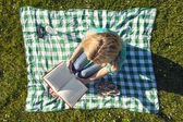 Young Woman Reading Book In Park, seen from above — Stock Photo