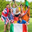 Stock Photo: International Athletes With Various National Flags Celebrating