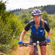 Woman on Mountain bike — Stock Photo