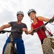 People on bikes — Stock Photo