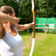 Woman target shooting — Stock Photo #31412275