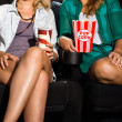Women With Popcorn And SodSitting In Theater — Stock Photo #31413621
