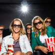 Young Friends Watching 3D Movie In Theater — ストック写真