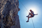 Abseiling woman — Stock Photo