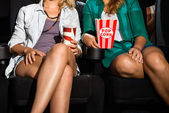 Women With Popcorn And Soda Sitting In Theater — Stock Photo