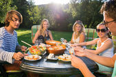 Friends Enjoying Meal At Garden Party — Stock Photo