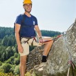 Confident Male Climber Standing On Rock — Stock Photo