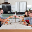 Friends enjoying dinner at home — Stock Photo