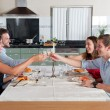 Friends enjoying dinner at home — Stock Photo #31970451