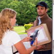 Stock Photo: Delivery guy at the door