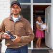 Delivery guy with Wireless PIN machine — Stock Photo